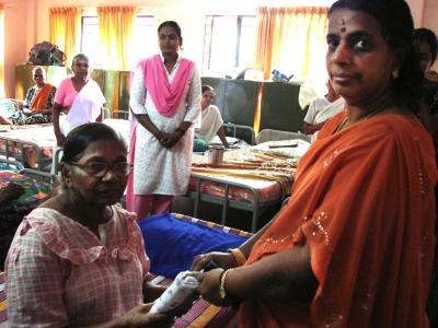 Distributing clothes to mahilamandiram inmates
